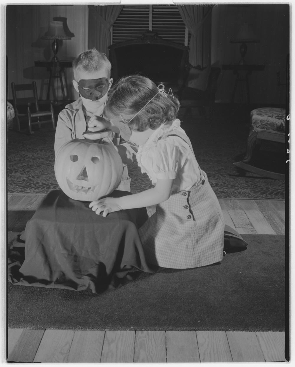 Kit Barrow and Betsy Speed with Halloween pumpkin.