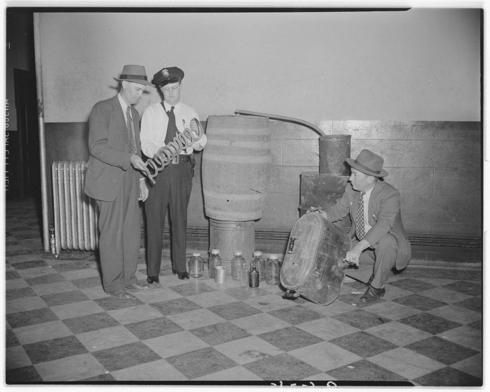 Sheriff Harvey Partin, Jessamine county, left, and Police Chief Carl Bruner, Nicholasville, examining parts of captured…